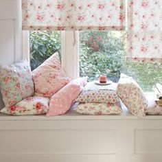 Lots of pretty pillows for a super-comfy window seat. cathkidston.com