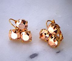 Swarovski elements 8mm rose gold fancy stone earrings by CrystallizedByLena, $22.00