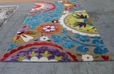 What do you think of this custom coloured KAS Suzani rug?? Lovely & bright!! #TheRugCollection
