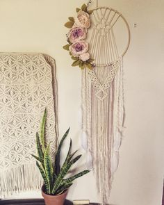Floral macrame dreamer in creams, whites and musky pink. #macrame #macramedreamcatcher #macramedreamer #dreamcatcher #bohodecor #bohostyle #bohemian #floral