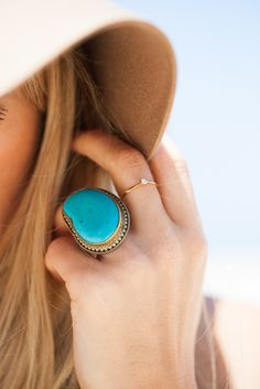 Yummy Turquoise ring, love the over sized with a ubber small one next to it.