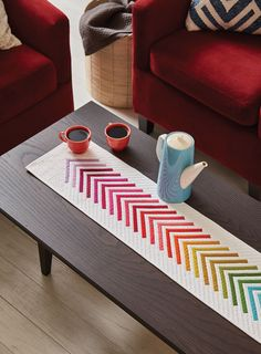 A creatively colorful modern table runner to add a pop of color to your home.