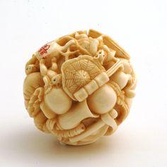 Mammoth Ivory Netsuke Ball. 'A Baby Playing With Feets'. Beautiful detail. #netsuke #carving #ball