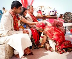 Bride in Red seeking Blessings by Parent's