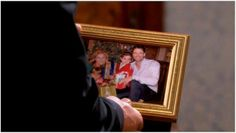 EJ looks at a family picture of him, Sami, and their kids Johnny and Sydney.