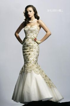"Beautiful ""Mermaid"" styled dress, complete with beaded artwork and sequins."