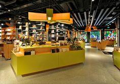 Tanum Karl Johan bookstore flagship by JVA, Oslo Bookstore Design, Library Design, Visual Merchandising, Cash Counter Design, Retail Counter, Shop Fittings, Retail Interior, Branding, Design Furniture
