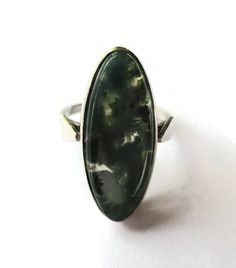 SOLD. Moss agate and sterling silver ring, vintage ring, green chalcedony, dendritic agate oval cabochon, mid century modern statement ring. https://www.etsy.com/uk/listing/449621058/moss-agate-and-sterling-silver-ring