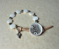 Mother of Pearl beaded wrap bracelet with antique silver floral closure.  Jewelry from The Mermaid Apothecary via etsy.com