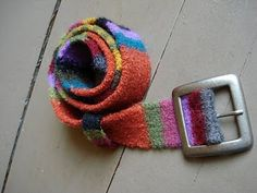 Knitted and felted belt.