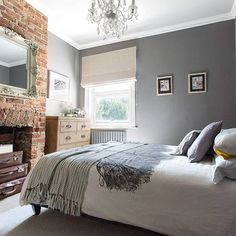 beautiful grey and white bedroom and feature red brick fireplace - Brick Wall Bedroom