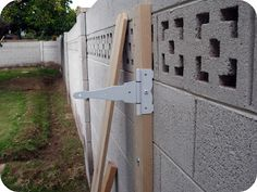 DIY Gate Tutorial-Attach the second 2X4 to the brick wall by screwing the 3.5″ bolts into the wood and into the anchors.  Use the washers to ensure a tight fit.
