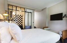 A new concept for a hotel : only 5 rooms in a truly Parisian apartment but with a hotel service. Right in Le Marais so very central. However, children under 12 are not allowed. Hotel 1er Etage | Hotel Paris Beaubourg | Photos Gallery - OFFICIAL SITE