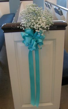 Tiffany Blue Pew Bow with Baby's Breath accent.  Perfect for any church.  Love the way the blue stands out against the White Pews.