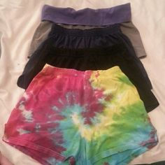 4 Pair Bundle! 4 shorts for the price of one! These are worn, but still have much life in them. Super comfortable. Minor signs of wear. Mostly in the tie dyed shorts. All different brands. One is No boundaries. The rest are from different sporting companies. One grey pair, with a purple thick band. One tie dyed. One navy blue and one black double layered. No Boundaries Shorts