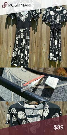 ANTHROPOLOGIE Ric Rac Midi Dress ANTHROPOLOGIE Ric Rac Midi Dress With Deep V-Neck, Floral Tie Waist and an Aline Skirt. Womans Juniors Anthropologie Dresses Midi