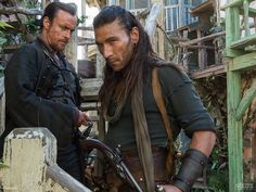 "Captain Flint (Toby Stephens) and Captain Vane (Zach McGowan) from ""Black Sails"""