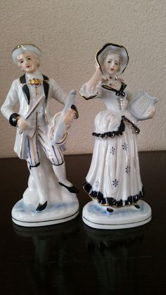 Vintage Set of man and woman with a violin and harp