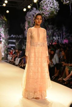Model walking the ramp at the Opening Night event