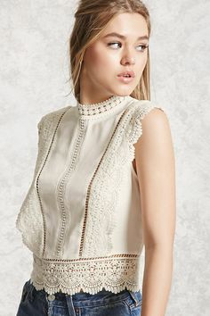 A semi-cropped woven top featuring a crochet trim, a mock neck, ladder cutout inserts, a sleeveless cut, and a button back. Mode Ootd, Outfit Trends, Lace Tops, Crochet Clothes, Crochet Dresses, Blouse Designs, Fashion Outfits, Fashion Skirts, Women's Fashion