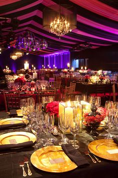 The soft glow of pillar and votive candles compliments golden charger plates.