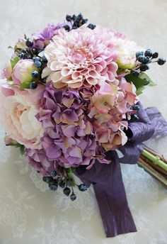Pink and purple bouquet with dark purple ribbon