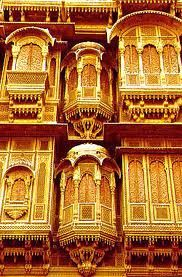 Several 'Jharokhas', of different sizes and styles [Kind of Bay-Windows] can be seen jutting out from the facade of this typical 'Haveli' at Jaisamer, Rajasthan, India