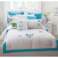 This soft and luxurious comforter set features a beautiful subtle floral embroidery on a bright background. The machine washable polyester set features 12 wonderful pieces to adorn the bed with.