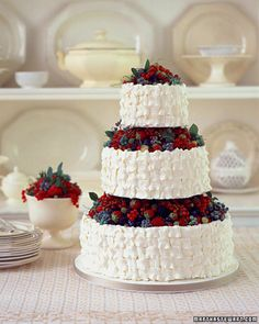 Early summer is the best time to choose a cake like this one -- brimming with a fresh and varied assortment of the season's best berries. Red currants, raspberries, gooseberries, blueberries, and strawberries look beautiful jumbled together on basket-weave tiers. The basket-weave effect was created using an oversize leaf tip. The cake's three tiers are supported by wooden dowels; the berries are arranged before the dowels are inserted, which helps hide the supports.