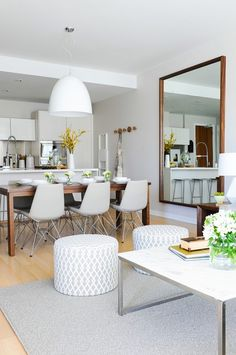 Enchanting Open Room Area of Dining and living room Design with Wood table and Coconut Chair and White Chandelier at False Creek Condo Design