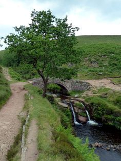 Waterfall and packhorse bridge at Three Shires Head