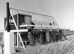 Elizabeth Reese leaning over the balcony of Architect Andrew Gellers first independent project the fittingly named Reese House in Sagaponack NY. (1955)