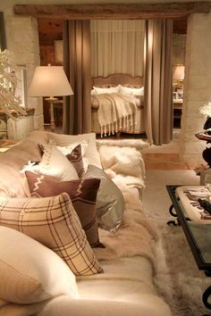 Luxe mountain lodge. Nice use of neutrals and texture for Master Bedroom