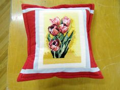red patchwork pillow, flowers