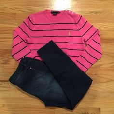 """NWOT Pink and navy polo sweater This is a beautiful pink and navy polo sweater. It's not a typical """"short"""" sweater like polo usually has. It's a great length, not long and not short. It has a beautiful button set on the top shoulder with a lime green horse embroidery. Great shirt! Ralph Lauren Sweaters Crew & Scoop Necks"""