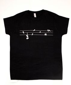 Available in Womens or Unisex sizes    T-Shirt has image of roller skates on a telephone wire with birds.  Image can be done in any colour you