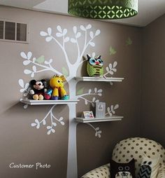 Love the combination of tree decal, neutral color palette, and floating shelves with toys...