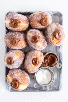 Fluffy brioche doughnuts are rolled in sugar, then filled with a silky salted caramel and milk chocolate ganache. These are the ultimate treat - the rich chocolate ganache is a total game changer. Cupcakes, Donut Recipes, Dessert Recipes, Milk Chocolate Ganache, Chocolate Donuts, Milka Chocolate, Sweet Tooth, Sweet Treats, Yummy Food
