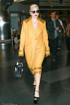 Cutting the mustard:Yet it appears Lady Gaga's days of outlandish ensembles are behind her as she looked incredibly demure after touching down in New York's JFK airport on Sunday