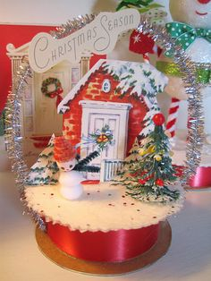 A ribbon spool is the base for this darling little retro Christmas vignette. (Christmas, decor)