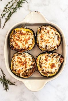 Recipe for an incredible and healthy mushroom, apple and sausage stuffed acorn squash. Perfect for dinner and lunch and makes for the ultimate winter meal! gluten and grain free. Leave the cheese out and make it paleo and whole30 approved
