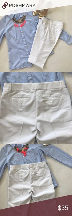 Express Design Studio Pants In good condition over all. It has minimal spots as noted in the pictures taken, they can probably be removed. Only worn twice. They are the Design Studio Collection.  They have two functional pockets in the front and back. 45% Polyester, 47% Cotton, 4% Spandex. 32 1/2 inch inseam. They are white. Size 0 Regular. Express Pants