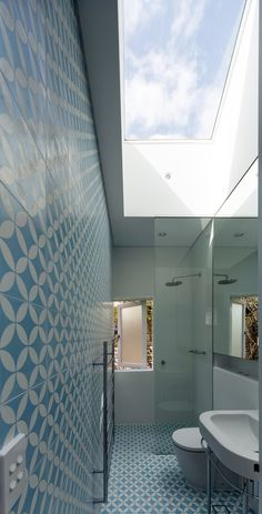 Cement tiled bathroom at  the Cosgriff House by Christopher Polly Architect