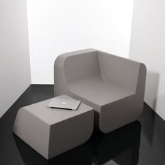 Dual Cut Chair - This piece is constructed from foam. I like the honesty to its materials. It comes from a very uniform material, and as such, it's cut from a single block with simple gestures and is without ornamentation.