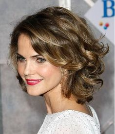 Keri Russell's new shorn locks. Here, Keri Russell's natural ringlets are blown out and worked into big, thick curls. To get this look: Blow out hair as straight as possible, then wind curls around the barrel of a curling iron. You'll want to switch directions so the curl looks natural. Wind some up, some down.