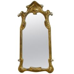 27.5X54 1900+ Italian Gilt Wood Carved Stylized Wall Mirror | From a unique collection of antique and modern wall mirrors at http://www.1stdibs.com/furniture/mirrors/wall-mirrors/