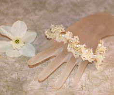 To Have and To Hold...  Handmade beadwoven bracelet for a bride, with all kinds of ruffles and frills made with faux pearls, by time2cre8.  :-)  59.00