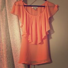 Peach Top Sheer peach top with ruffle front. Can be tied with attached ribbon belt to the front or back. Can be worn with a casual or dressy outfit. Gently worn. Forever 21. Size small. Forever 21 Tops Blouses