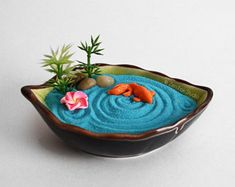 """cute-thangsss: """" Tiny Zen Garden Koi Pond This miniature ceramic leaf shaped zen garden features a Koi Pond! Great for display on any desk, bookshelf, or work space. If you need to relax, hold the. Miniature Zen Garden, Mini Zen Garden, Bamboo Stalks, Indian Pillows, Unique Gardens, Zen Gardens, Fairy Garden Houses, Garden Features, Leaf Shapes"""