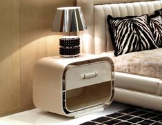 Italian low bedside table / nightstand with top in shiny brushed polyester lacquered Ebony Makassar and perimeter in leather with a stainless steel base. Grand Tour is a luxury furniture collection with a sporting design inspired by first class travel and the world of luxury automobiles. Made in Italy.